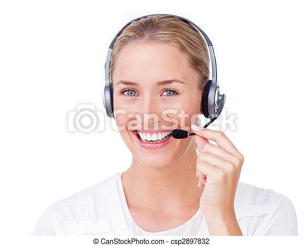 Smiling customer service representative using headset  - csp2897832