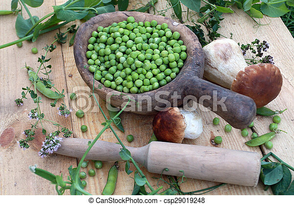 Green peas and mushrooms in a woode