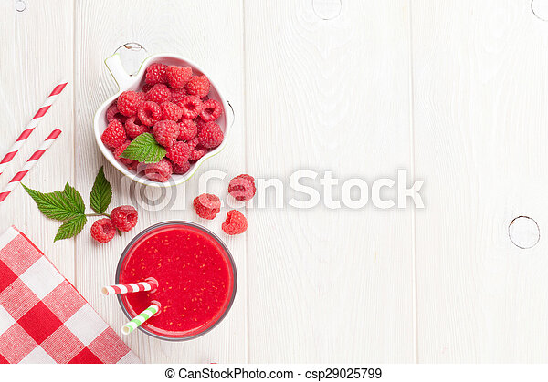 Raspberry smoothie and berries in bowl
