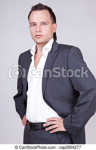 Portrait of harsh business male model stare to you.