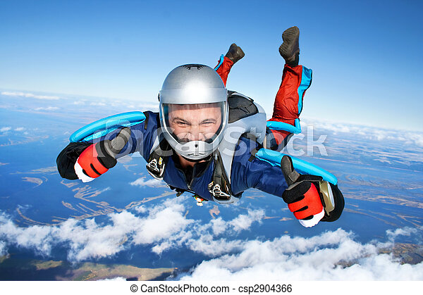 Skydiver falls through the air - csp2904366