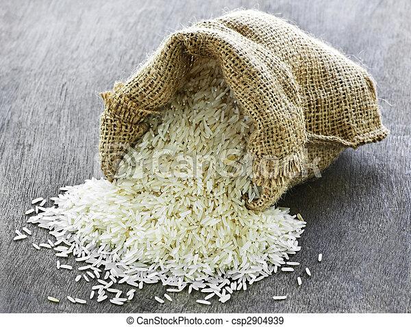 Long grain rice in burlap sack - csp2904939