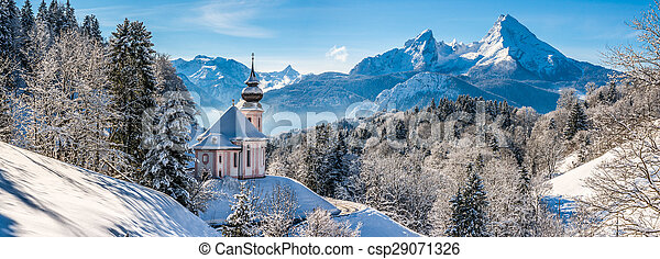 Panoramic view of beautiful winter landscape in the Bavarian Alps with pilgrimage church of Maria Gern and famous Watzmann massif in the background, Nationalpark Berchtesgadener Land, Bavaria, Germany - csp29071326