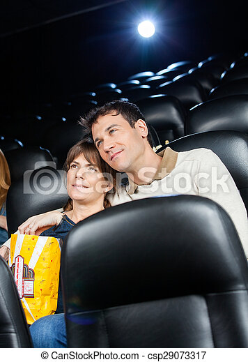 Affectionate Couple Watching Film In Theater - csp29073317