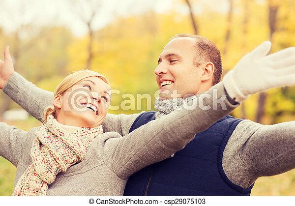 smiling couple in autumn park