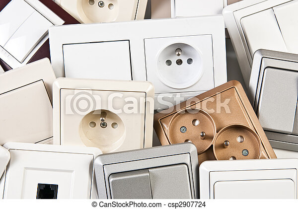 couple of electrical colorful switches and sockets - csp2907724