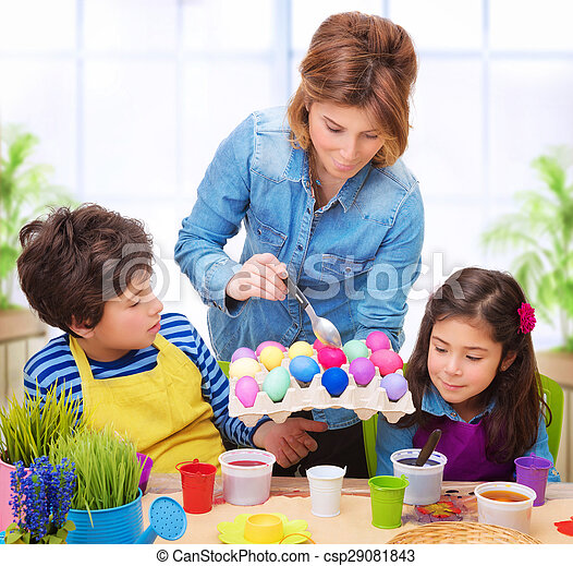 Happy family paint Easter eggs