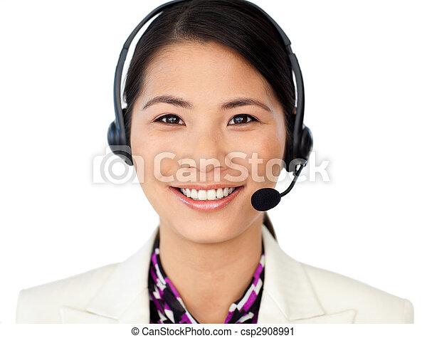 Smiling customer service representative using headset - csp2908991