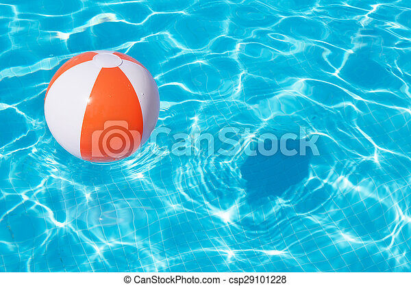 Colorful beach ball floating in a pool
