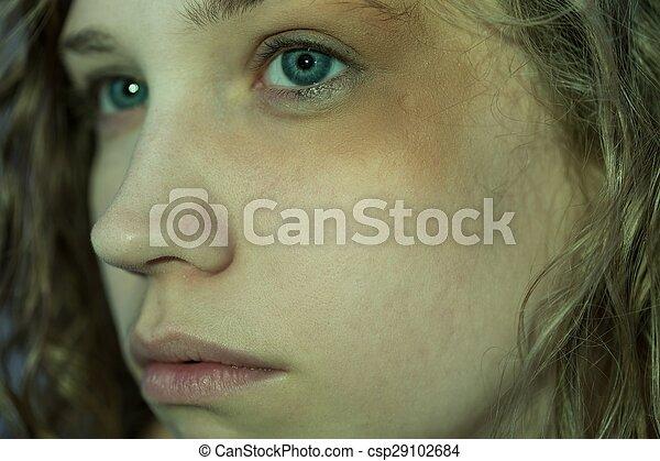 Beaten woman with black eye
