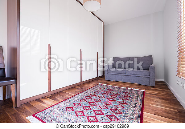 Pattern carpet on wooden floor