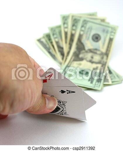 Poker player views pocket pair aces poker, cash bet - csp2911392