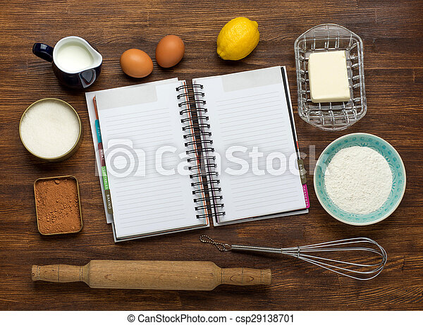 Baking cake in rural kitchen - dough recipe ingredients: eggs, flour, milk, butter, sugar on vintage wooden table from above. Background layout with free text space.