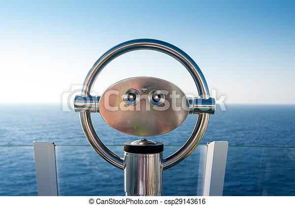 Binoculars on hill next to the ocean - csp29143616