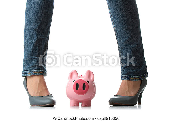 Young woman about to smash piggy bank  - csp2915356
