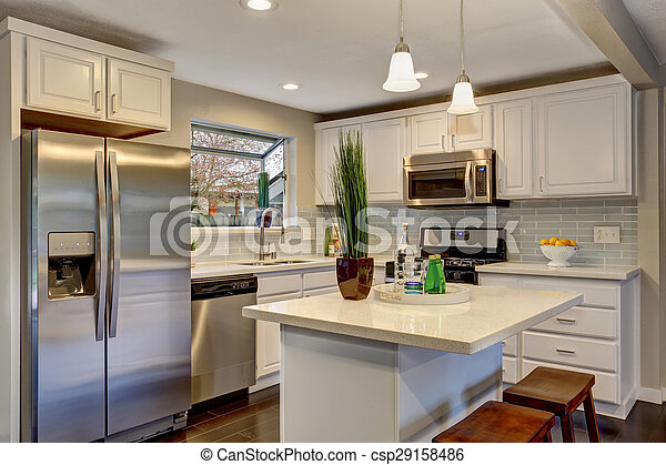 Nice kitchen in modern home including island and white counter tops.