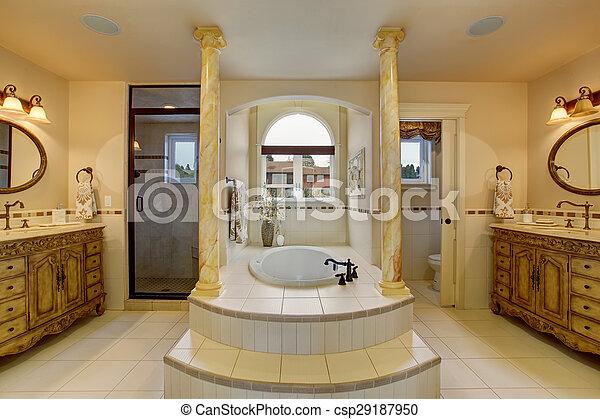 Large luxury bathroom with centerd bathub.