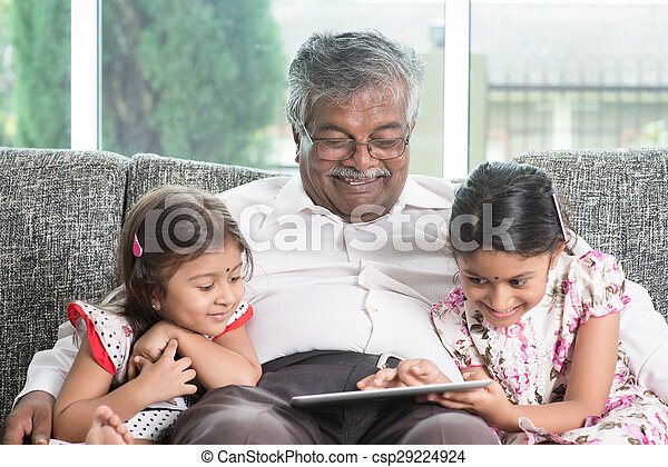 Grandfather and granddaughter using modern technology