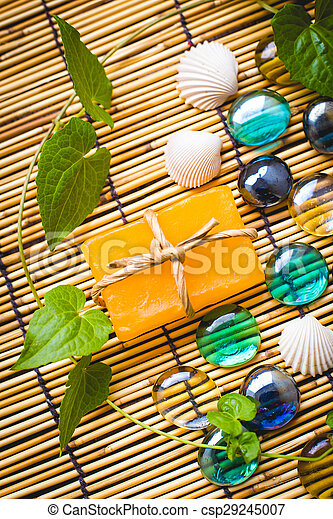 Spa, Handmade soap on wooden table.