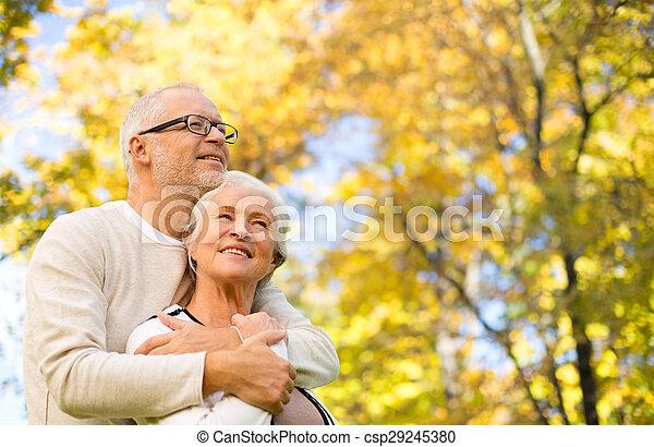 happy senior couple in autumn park