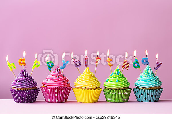 Cupcakes with candles spelling the words \