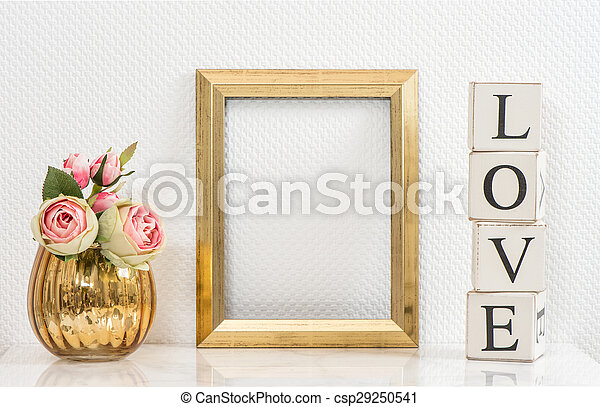 Mock up with golden frame and flowers. Love concept