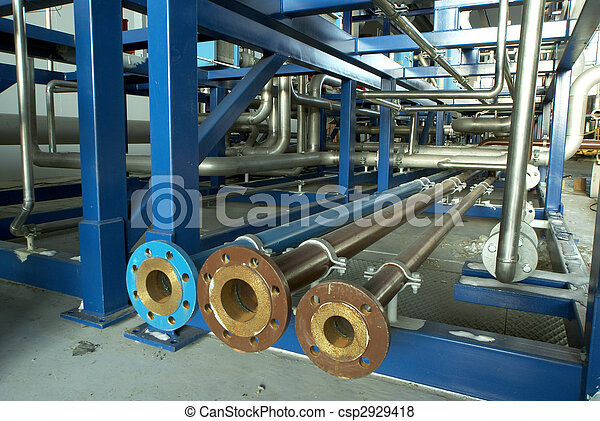 Equipment, cables and piping as found inside of a modern industrial power plant                  - csp2929418