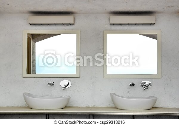 Front View Of Two Sinks With Modern Faucets And Mirrors