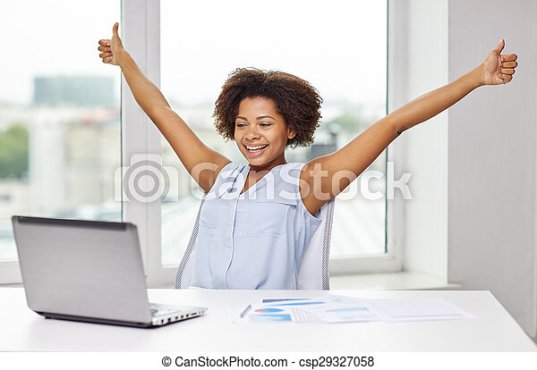 happy african woman with laptop at office