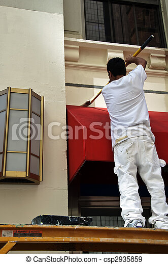 male painting outside of building from scaffolding - csp2935859