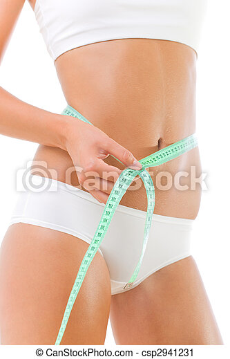 Beautiful slim woman measuring her waist - csp2941231