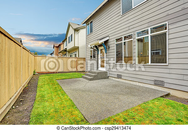Lovely back yard with patio and fence.