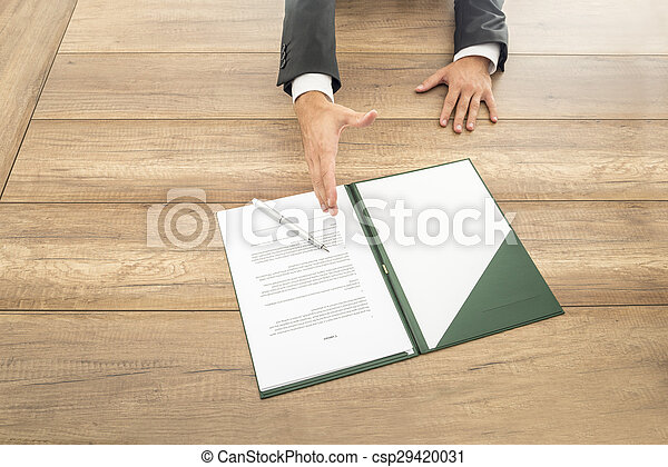 Businessman waiting to shake hands over a contract