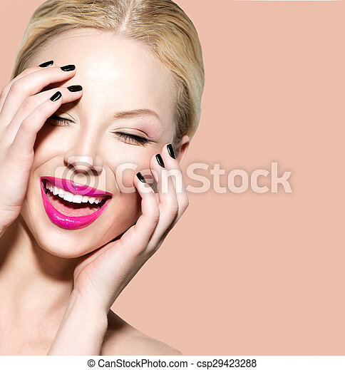 Laughing beautiful young woman with clean fresh skin