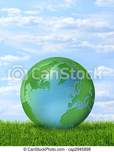 Green planet on green grass and blue sky - csp2945898
