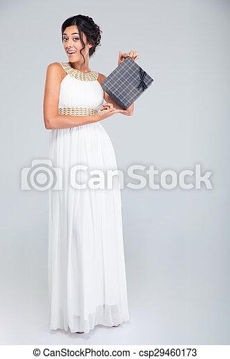 Beautiful woman in dress holding gift box