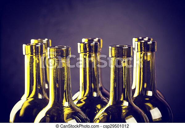 Closeup of empty bottles of wine