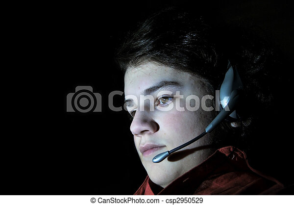 Young teenage adult with headset - csp2950529