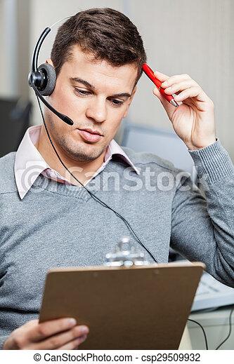 Confused Customer Service Representative Holding Clipboard