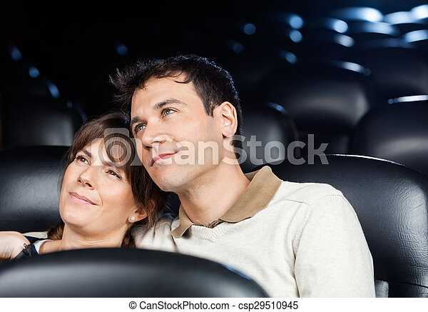 Loving Couple Watching Movie In Theater - csp29510945