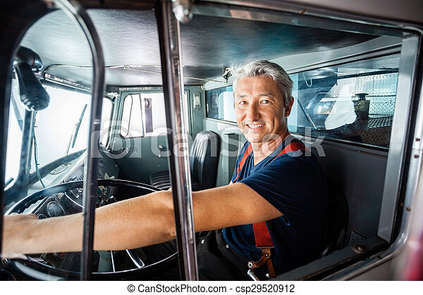 Happy Fireman Driving Firetruck