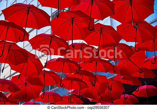 Red Umbrellas In the Air