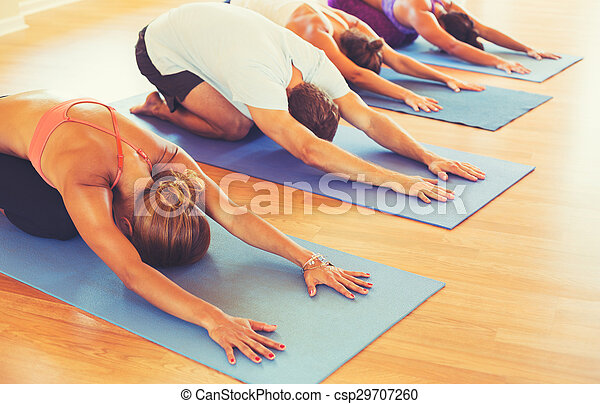 People Relaxing and Doing Yoga