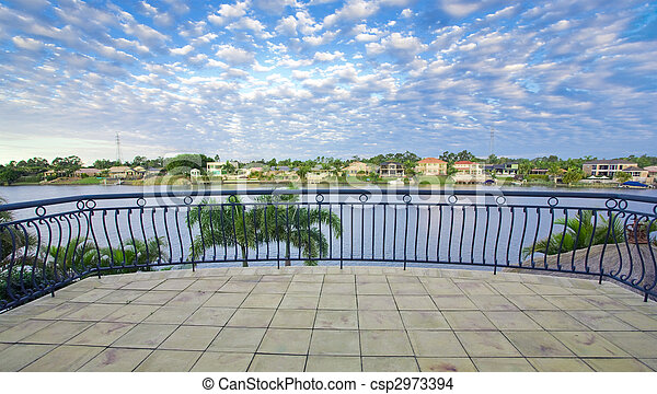 Balcony views from waterfront Mansion overlooking the canal - csp2973394