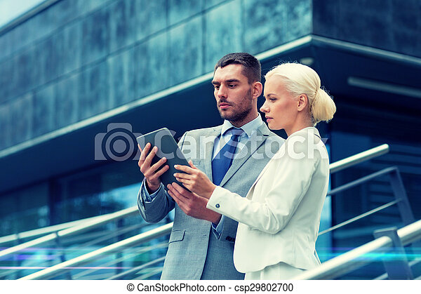 businesspeople with tablet pc outdoors