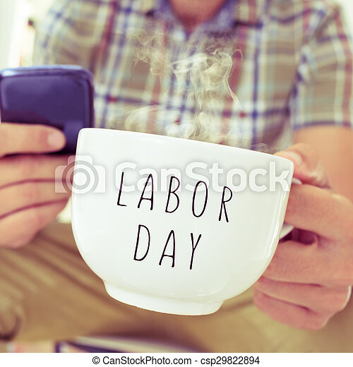 young man with a mug with the text labor day