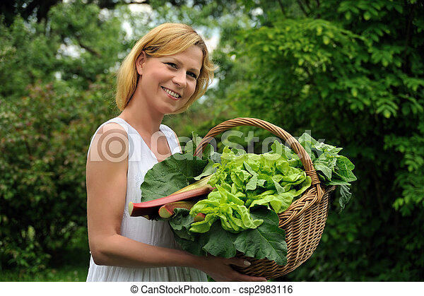 Young woman holding basket with vegetable - csp2983116