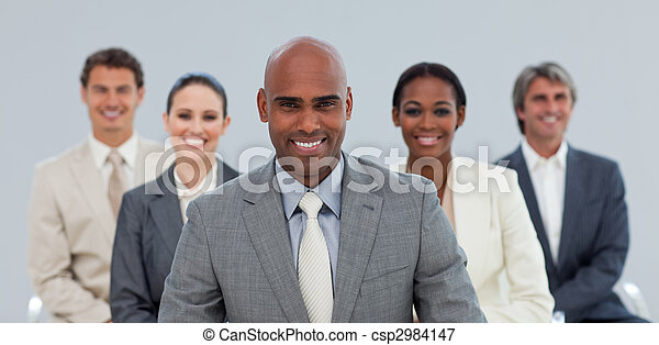 Charismatic Ethnic businessman with his team smiling  - csp2984147