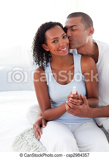 Excited couple finding out results of a pregnancy test  - csp2984357