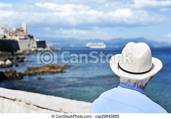 old man looking at the sea in Antibes, France, filtered